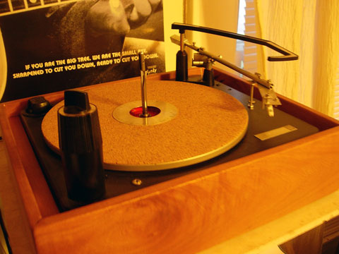 The Spring On Arm Makes Sure Does Not Flip Backwards When Record Player Changes Records It Only Lies Tension Is In Up